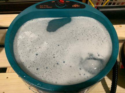 ポット洗浄中を加熱ボウルに入れ、洗浄している写真